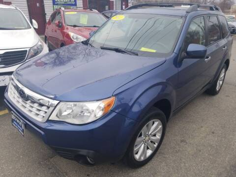 2011 Subaru Forester for sale at Howe's Auto Sales in Lowell MA