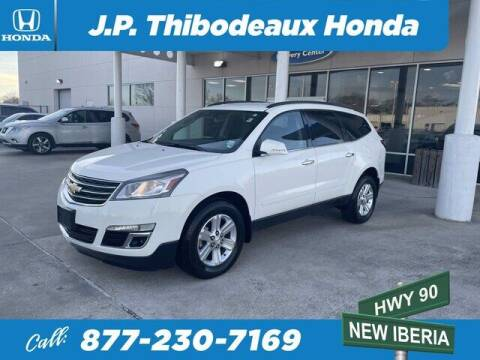 2014 Chevrolet Traverse for sale at J P Thibodeaux Used Cars in New Iberia LA