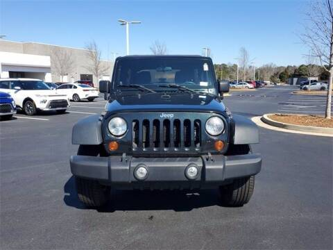 2012 Jeep Wrangler Unlimited for sale at Lou Sobh Kia in Cumming GA