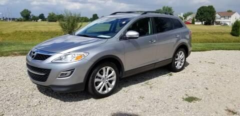 2011 Mazda CX-9 for sale at CALDERONE CAR & TRUCK in Whiteland IN