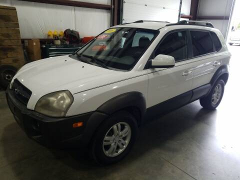 2006 Hyundai Tucson for sale at Hometown Automotive Service & Sales in Holliston MA