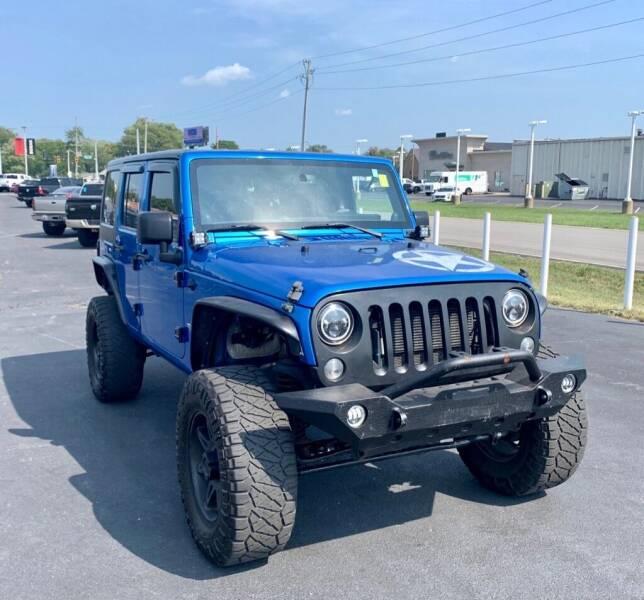 2014 Jeep Wrangler Unlimited for sale at Blum's Auto Mart in Port Orange FL