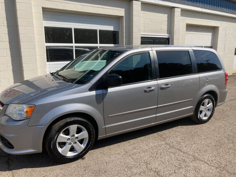 2013 Dodge Grand Caravan for sale at Ogden Auto Sales LLC in Spencerport NY