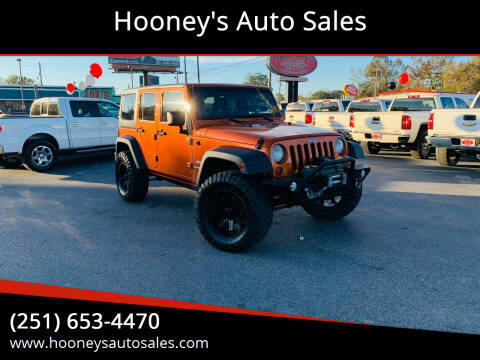 2011 Jeep Wrangler Unlimited for sale at Hooney's Auto Sales in Theodore AL