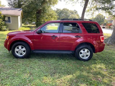 2011 Ford Escape for sale at Bo Bowlin Automotive in Loganville GA