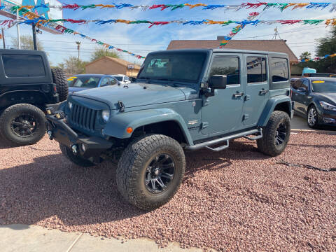 2014 Jeep Wrangler Unlimited for sale at A AND A AUTO SALES in Gadsden AZ