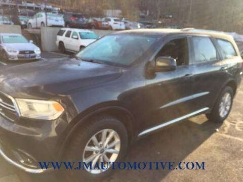 2014 Dodge Durango for sale at J & M Automotive in Naugatuck CT