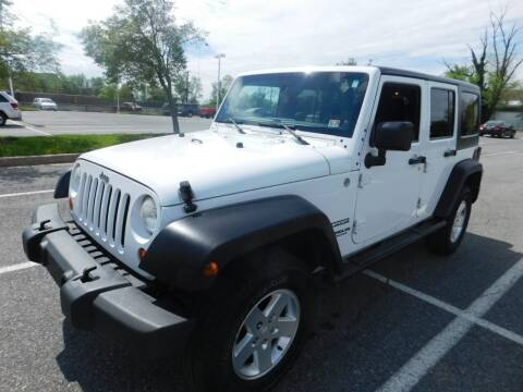 2012 Jeep Wrangler Unlimited for sale at AMERICAR INC in Laurel MD