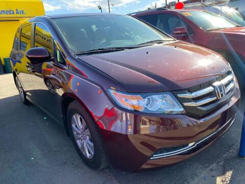 2015 Honda Odyssey for sale at New Wave Auto Brokers & Sales in Denver CO
