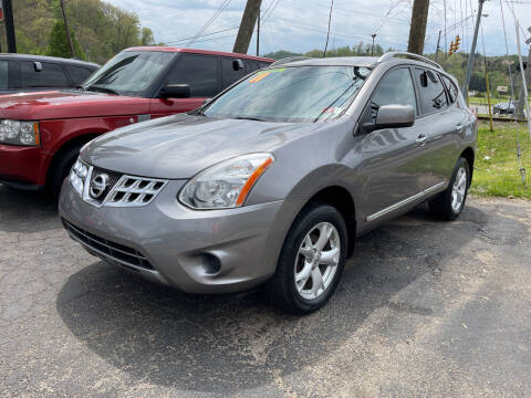 2011 Nissan Rogue for sale at PIONEER USED AUTOS & RV SALES in Lavalette WV