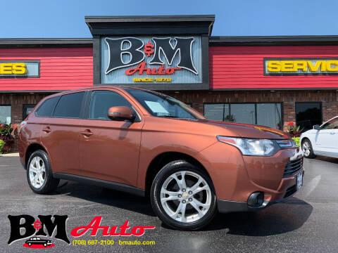 2014 Mitsubishi Outlander for sale at B & M Auto Sales Inc. in Oak Forest IL