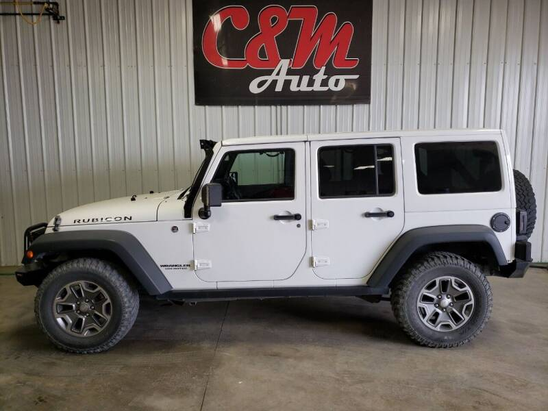 2014 Jeep Wrangler Unlimited for sale at C&M Auto in Worthing SD
