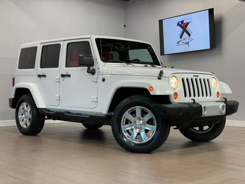 2013 Jeep Wrangler Unlimited for sale at TX Auto Group in Houston TX
