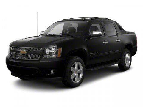 2013 Chevrolet Avalanche for sale at HILAND TOYOTA in Moline IL
