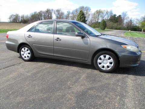 2006 Toyota Camry for sale at Crossroads Used Cars Inc. in Tremont IL