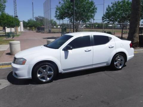 2013 Dodge Avenger for sale at J & E Auto Sales in Phoenix AZ