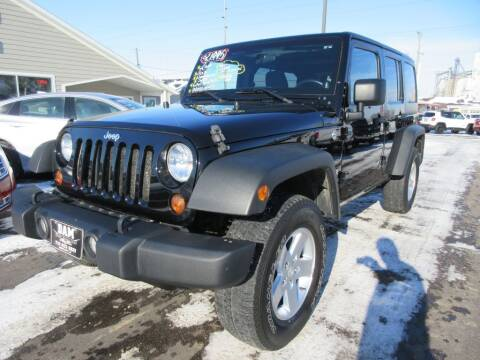 2011 Jeep Wrangler Unlimited for sale at Dam Auto Sales in Sioux City IA