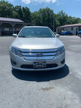 2010 Ford Fusion for sale at RHK Motors LLC in West Union OH