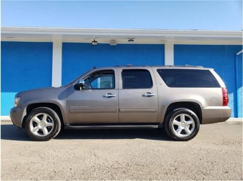 2012 Chevrolet Suburban for sale at Khodas Cars in Gilroy CA
