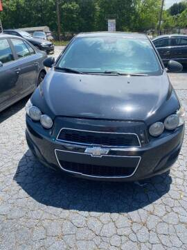2012 Chevrolet Sonic for sale at LAKE CITY AUTO SALES in Forest Park GA