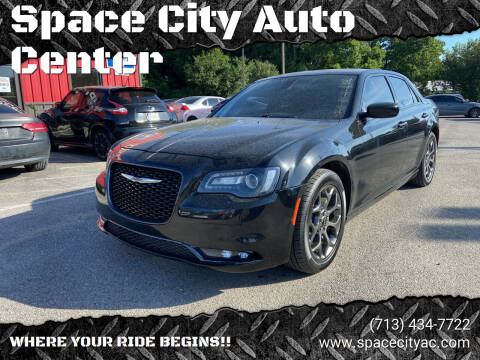 2016 Chrysler 300 for sale at Space City Auto Center in Houston TX