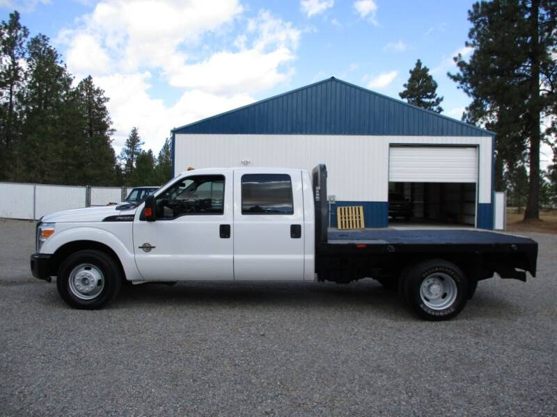 2014 Ford F350 CREWCAB FLATBED DUALLY for sale at BJ'S COMMERCIAL TRUCKS in Spokane Valley WA