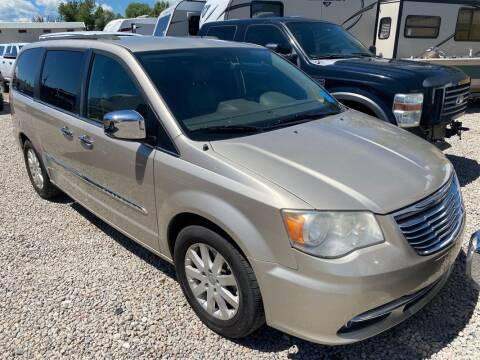 2012 Chrysler Town and Country for sale at BERKENKOTTER MOTORS in Brighton CO