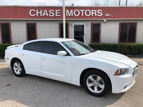 2014 Dodge Charger for sale at Chase Motors Inc in Stafford TX