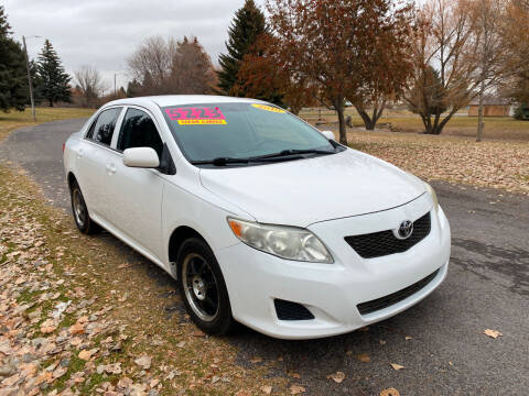 2010 Toyota Corolla for sale at BELOW BOOK AUTO SALES in Idaho Falls ID