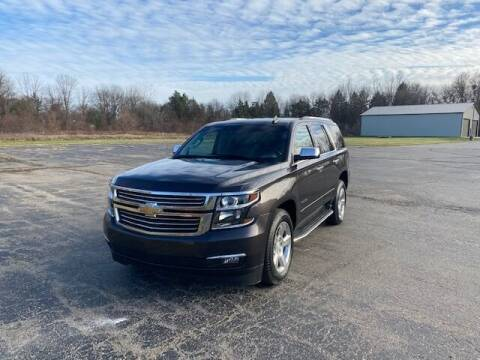 2015 Chevrolet Tahoe for sale at Caruzin Motors in Flint MI