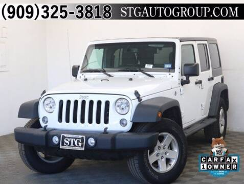 2016 Jeep Wrangler Unlimited for sale at STG Auto Group in Montclair CA