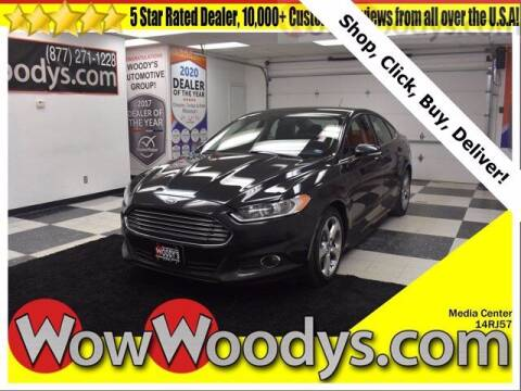 2014 Ford Fusion for sale at WOODY'S AUTOMOTIVE GROUP in Chillicothe MO