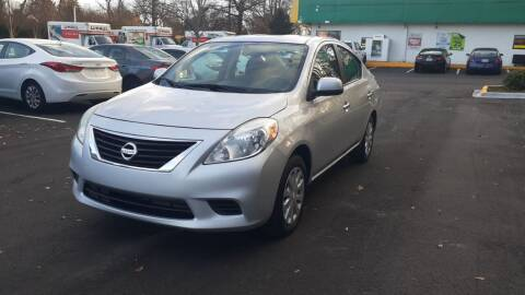 2013 Nissan Versa for sale at Alfa Auto Sales in Raleigh NC