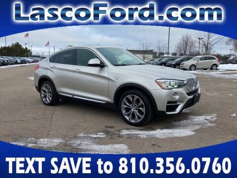 2016 BMW X4 for sale at LASCO FORD in Fenton MI