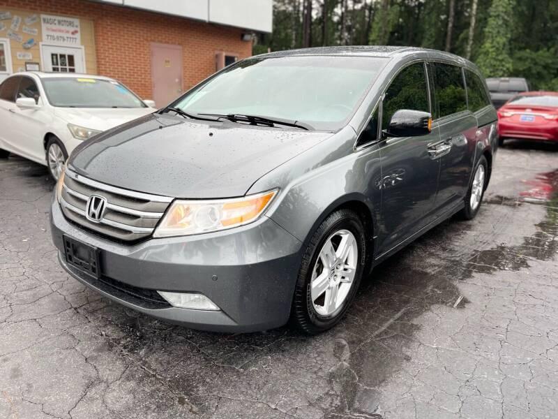 2012 Honda Odyssey for sale at Magic Motors Inc. in Snellville GA