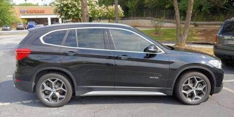 2016 BMW X1 for sale at C & J International Motors in Duluth GA