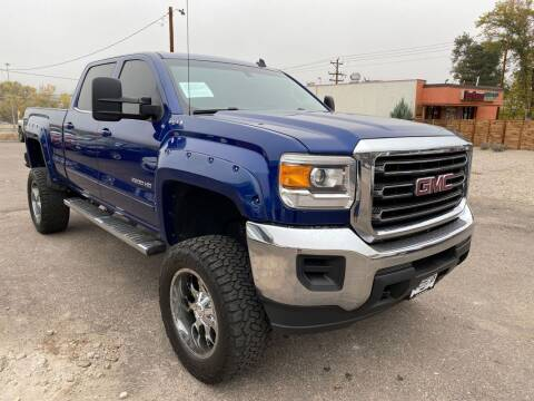 2015 GMC Sierra 2500HD for sale at BERKENKOTTER MOTORS in Brighton CO