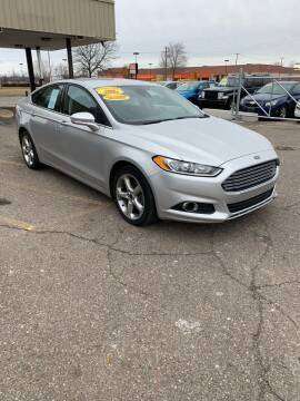 2016 Ford Fusion for sale at Big Three Auto Sales Inc. in Detroit MI