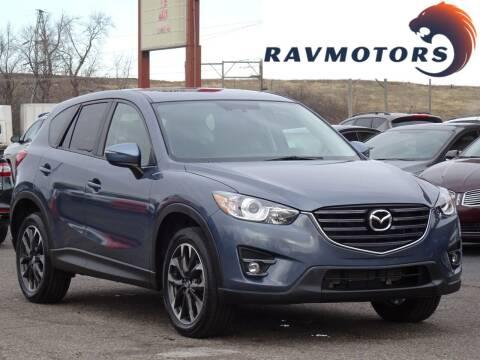 2016 Mazda CX-5 for sale at RAVMOTORS in Burnsville MN