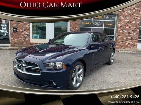 2014 Dodge Charger for sale at Ohio Car Mart in Elyria OH