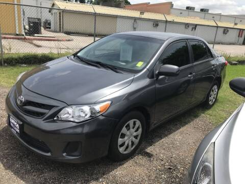 2011 Toyota Corolla for sale at AMIGO USED CARS in Houston TX