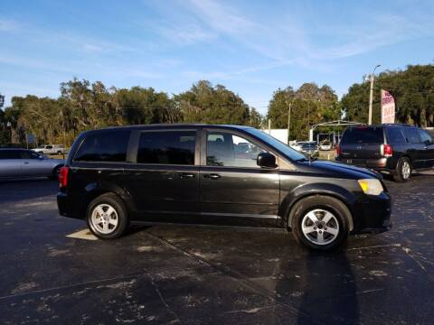 2012 Dodge Grand Caravan for sale at BSS AUTO SALES INC in Eustis FL