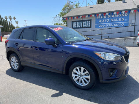 2013 Mazda CX-5 for sale at Blue Diamond Auto Sales in Ceres CA