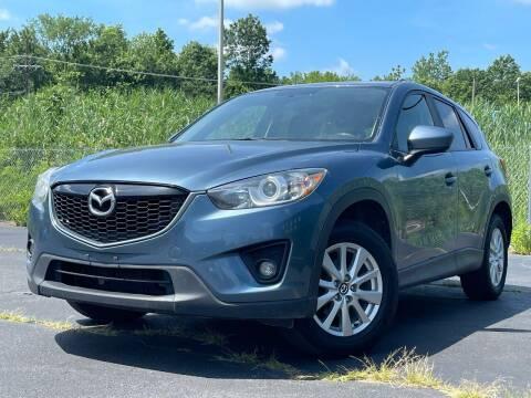 2015 Mazda CX-5 for sale at MAGIC AUTO SALES in Little Ferry NJ