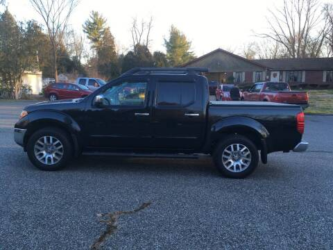 2012 Nissan Frontier for sale at Lou Rivers Used Cars in Palmer MA