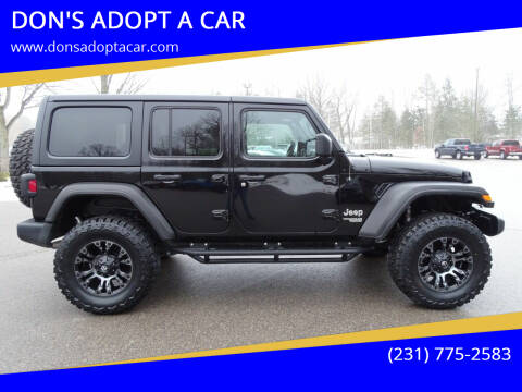 2019 Jeep Wrangler Unlimited for sale at DON'S ADOPT A CAR in Cadillac MI