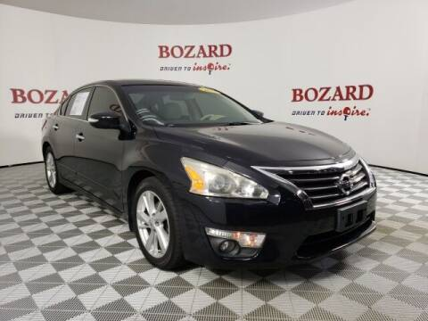 2013 Nissan Altima for sale at BOZARD FORD in Saint Augustine FL