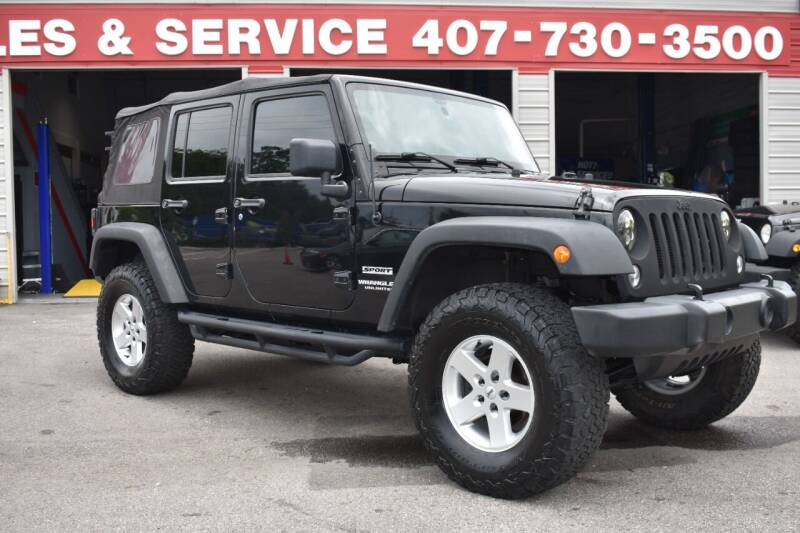2014 Jeep Wrangler Unlimited for sale at Mix Autos in Orlando FL