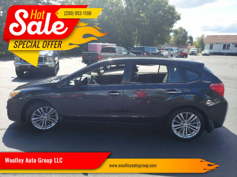 2012 Subaru Impreza for sale at Woolley Auto Group LLC in Poland OH