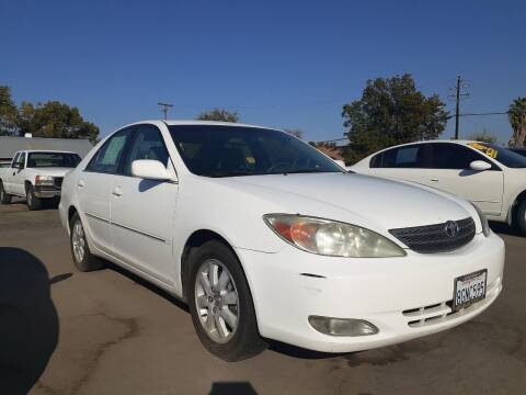 2003 Toyota Camry for sale at COMMUNITY AUTO in Fresno CA